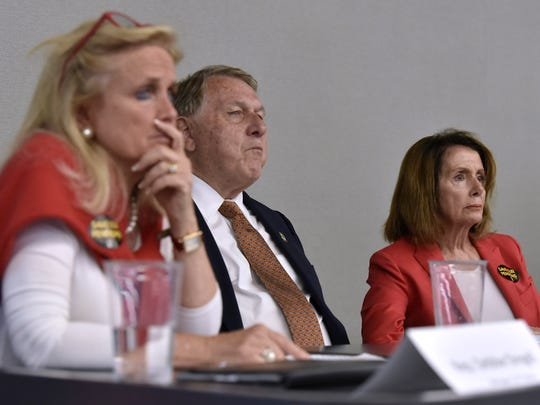 U.S. Representatives Debbie Dingell, left, and Nancy Pelosi, right, and Teamsters General President Jimmy P. Hoffa, center, listen to active union members and union retirees concerns about their pensions.