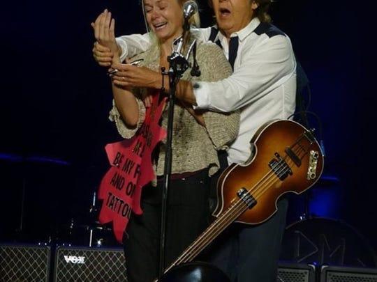 Jenna Newsome of Los Angeles gets here time in the spotlight with Paul McCartney