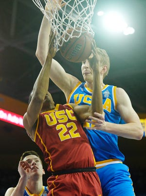 UCLA Bruins center Thomas Welsh (40) defends on a scoring attempt against Southern California Trojans guard De'Anthony Melton (22) during the first half at Pauley Pavilion.