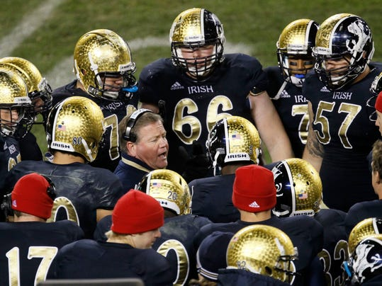 FILE - In this Oct. 6, 2012, file photo, Notre Dame head coach Brian Kelly talks to his team during the second half of an NCAA college football game against Miami, at Soldier Field in Chicago.  The NCAA has denied Notre Dame's appeal of a decision to vacate 21 victories because of academic misconduct, including all 12 wins from the school's 2012 national championship game run. (AP Photo/Charles Rex Arbogast, File)
