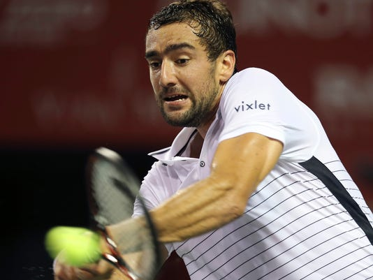 Croatia's Marin Cilic returns a shot against Benoit Paire of France during the first round match of Japan Open men's tennis championships in Tokyo, Monday, Oct. 3, 2016. (AP Photo/Koji Sasahara)