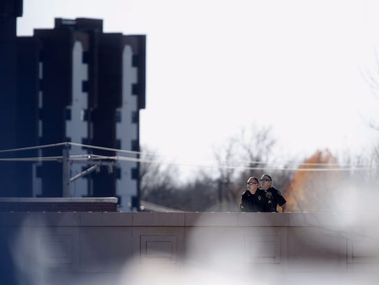 Police officers on a roof in downtown Springfield try