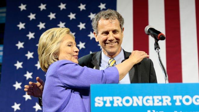 Presidential candidate Hillary Clinton hugs U.S. Senator Sherrod Brown as he introduces her during a campaign stop for the presumptive Democratic Party presidential nominee at the University of Cincinnati on July 18.