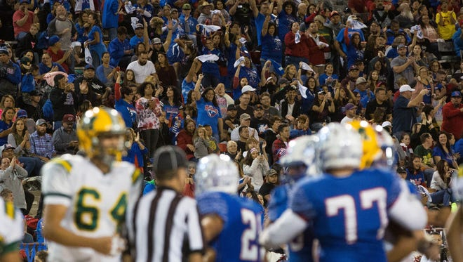 Las Cruces High School Fans cheer after the Bulldawgs scored a touchdown in the first half of their rivalry game against Mayfield High School. Friday November 3, 2017.