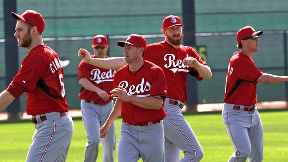 Reds pitchers stretch out Thursday morning in Goodyear.