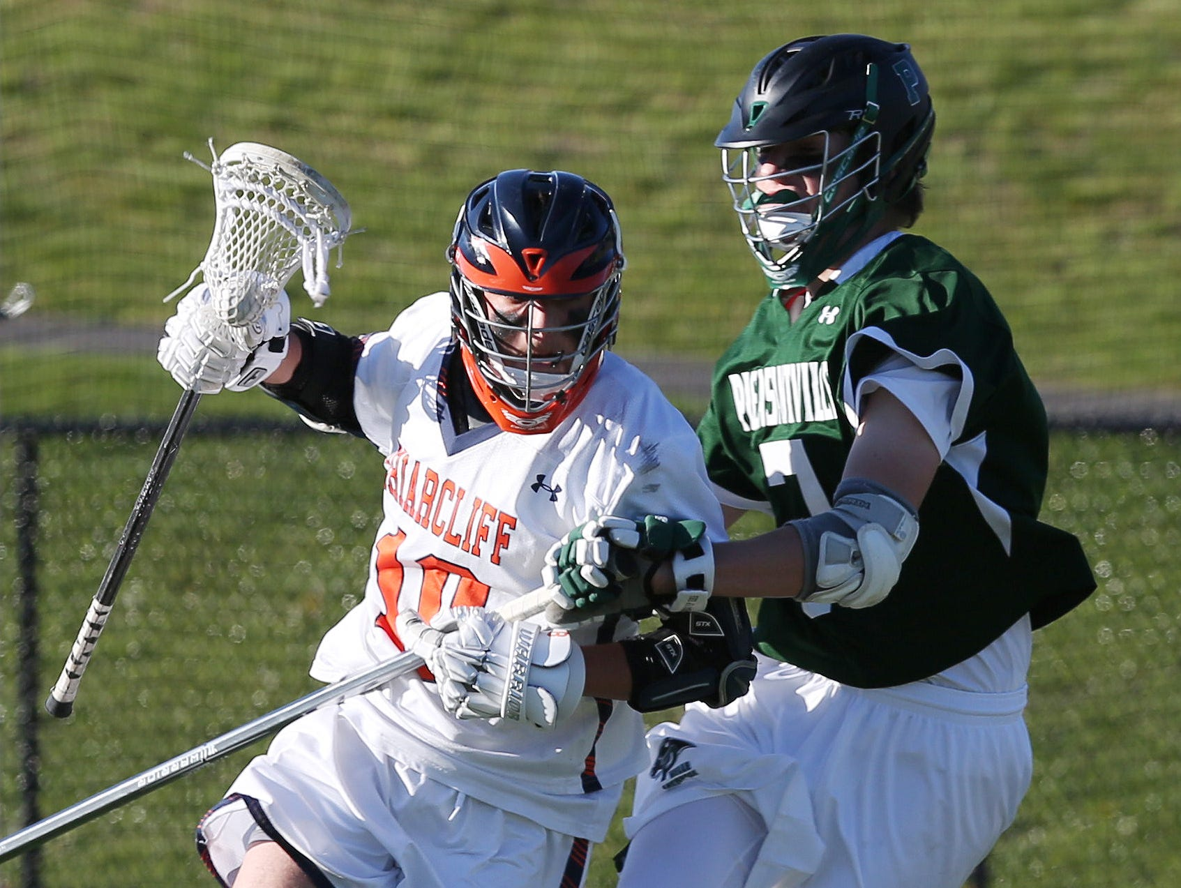 From left, Briracliff's Nicke Cebel (10) tries to get around Pleasantville's Cullen Dell (7) during a lacrosse game at Briarcliff High School April 20, 2016. Briarcliff won the game 8-7.