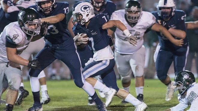 Central Valley Christian's Connor Paden (7) runs against Dinuba in a Central Sequoia League football game earlier this season.