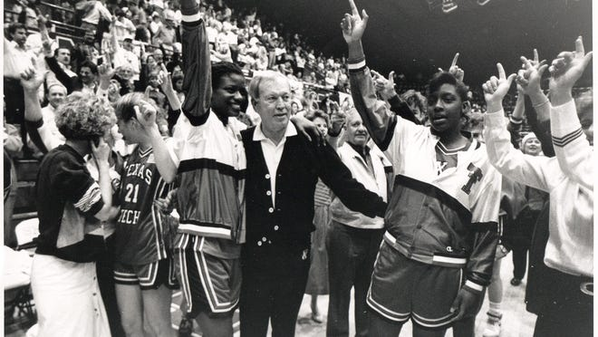 Texas Tech athletics director T. Jones celebrates with Lady Raiders basketball players. The Lady Raiders won the national championship in 1993, which was late in Jones' eight-year tenure as Tech AD. [PROVIDED BY TEXAS TECH ATHLETICS]