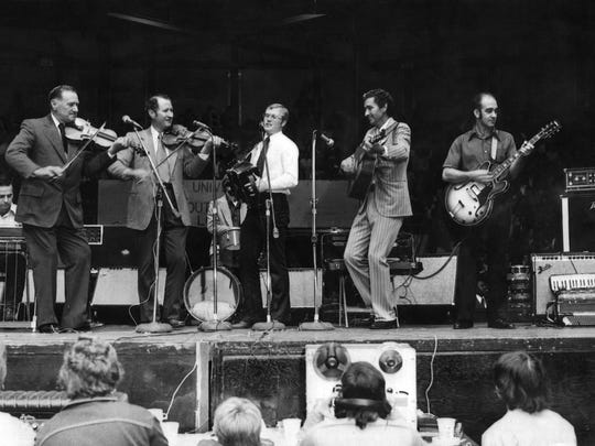 Ray Abshire, with accordion, performs with the Balfa Brothers at the Tribute to Cajun Music in 1974 in Blackham Coliseum.