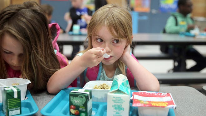 View Ridge Elementary student Serenity Levingston, 6, eats breakfast in the school gymnasium on Friday. This fall, Bremerton schools will no longer offer free breakfast to all elementary students.
