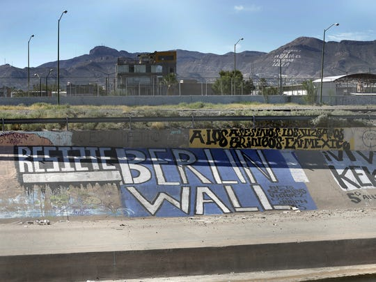 Graffiti on the Mexican side of the Rio Grande lets the Border Patrol know how Mexico feels about the border near Downtown El Paso.