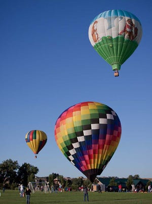 Hot-air balloons take flight during a previous Windsor Harvest Festival. The festival celebrates its 95th year this Labor Day weekend.