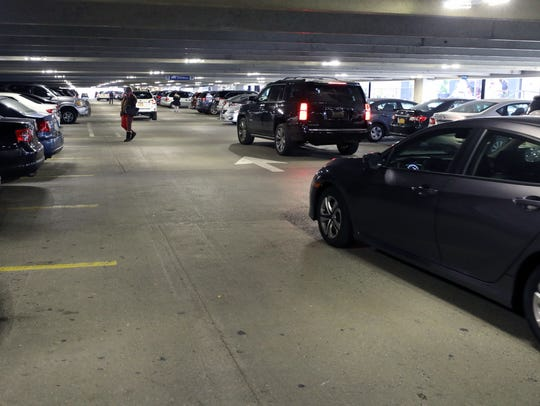 Vehicles navigate through the parking garage at the