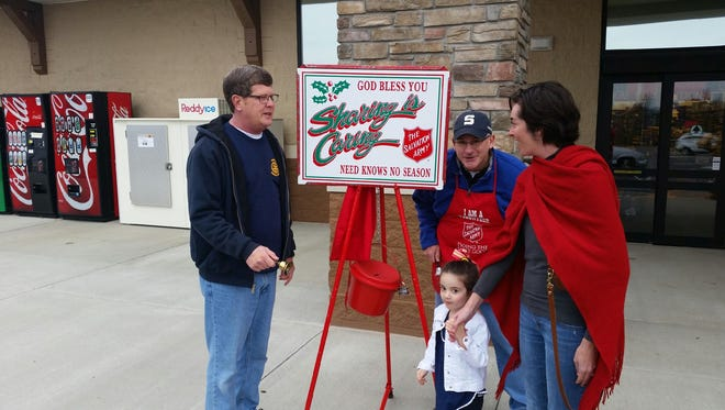 Stewart Brunner (left) and Bob Heist collect donations for Salvation Army on Saturday morning at the new Harps on U.S. 62 West.