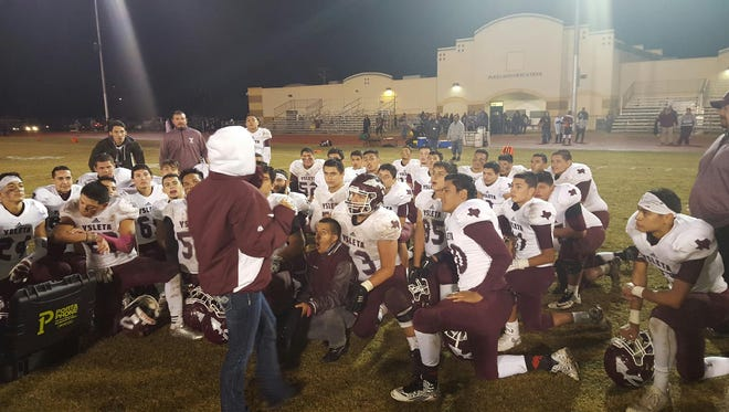The 2015 Ysleta team takes a knee after a victory to secure a playoff spot.