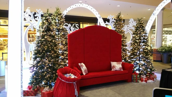The new Santa set at Rockaway Townsquare mall includes Christmas-oriented decorations, unlike glacier-dominated nontraditional decorations the company installed at five other malls, which created a storm of criticism for ignoring Christmas.