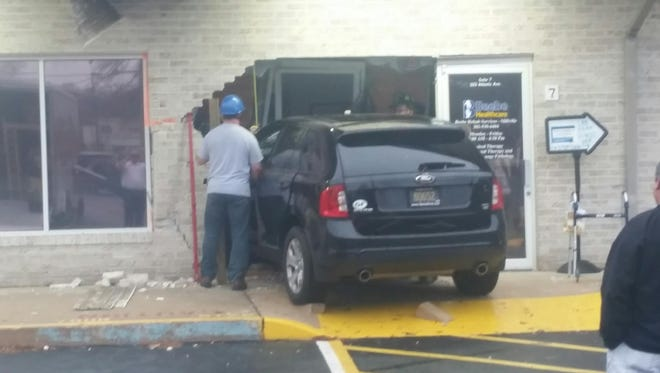 A 75 year old man crashed his car into the front of a medical rehabilitation building in Millville Wednesday afternoon.