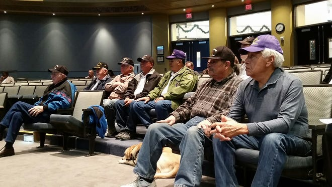 A group of Purple Heart recipients attends a Las Cruces City Council meeting on Monday to show support for a grant that will pay for a new monument in a city park that honors Purple Heart veterans.