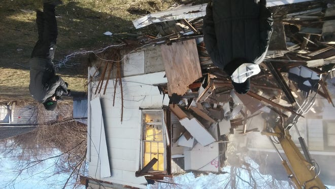 The Gary home once at the center of a multi-agency police investigation into demonic activity has been demolished Jan. 19, 2016.