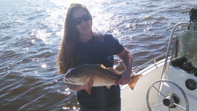 Dale Dixon, Renea Dixon and Dawn Pope caught several redfish in late March in Pensacola Bay.