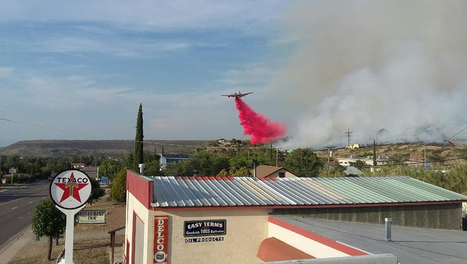 An air tanker drops retardant over a wildfire in Yarnell on June 8, 2016.