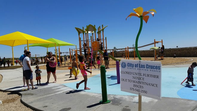 Parents and children lingered at the Metro Verde Splash Park in northeast Las Cruces on Thursday after the facility was abruptly closed a day earlier because of maintenance problems. The facility, 7125 Metro Park St., opened two weeks ago.