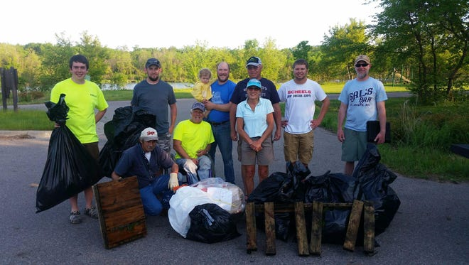 The Granite City Bassmasters clean up crew that gathered in May included (front row, left to right) Kerry Bridge, Dave Johnson, Nasha Martin; and (back row, left to right) Brandon Donovan, Tony Sindt, Mike Heinen, Pat Martin, Tyler Gromberg and Bob Beaman.