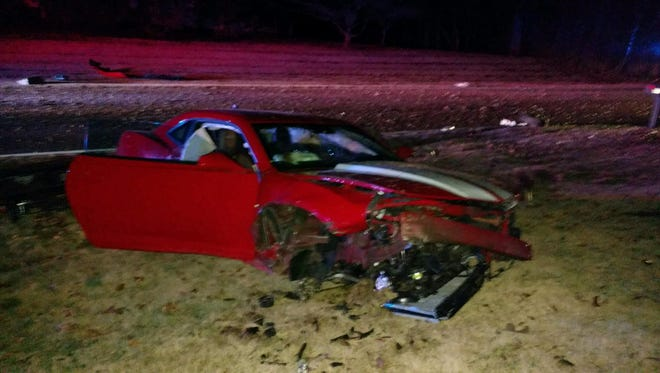 The Chevy Camaro that crashed on Old State Road Sunday morning.