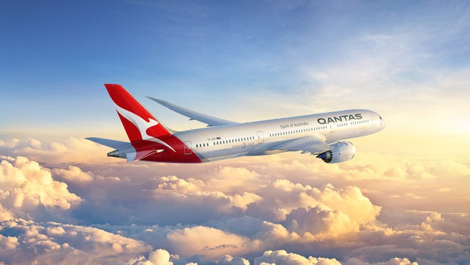 This rendering provided by Qantas shows a Boeing 787 Dreamliner in the airline's new paint scheme.