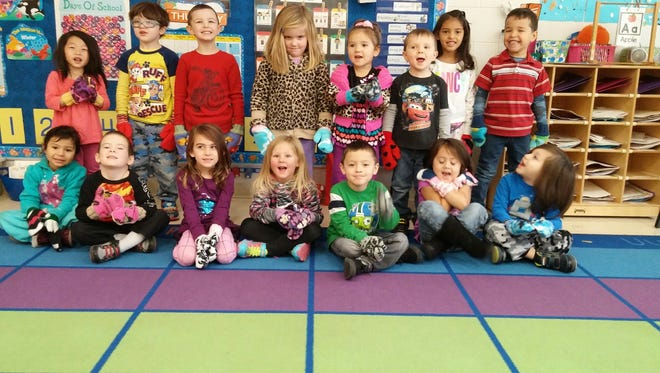 Students in Ms. LeAnne Powers Head Start received handmade fleece mittens from their Wisconsin Bookworms volunteer readers. Pictured, from left (First row): Danna, Lliam, Vayda, Kenzie, Cruze, Yaretzi and Ian; (Back row):Anzie, Christian, Drayden, Molly, Isabel, Rudy and Joshua; (Far back): Angela.