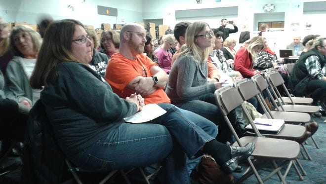 Parents listen to the Huron Valley Schools Board of Education talk about closing Brooks Elementary.