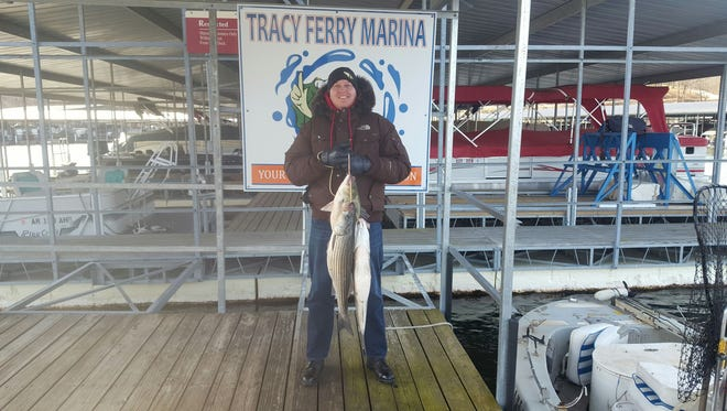 A regular client of Tom's with his recent catch at Norfork Lake.