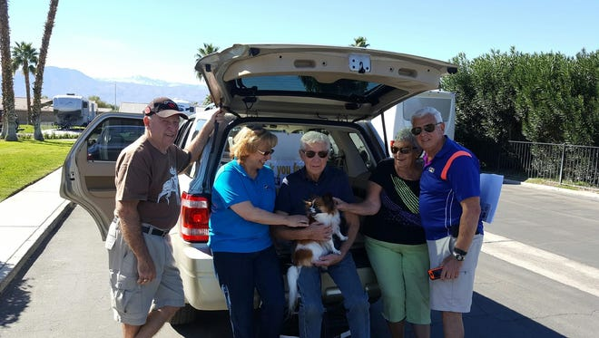 Residents of the Indian Waters RV Resort and Cottages say hello to a furry friend after donating more than $500 to Animal Samaritans on Jan. 30, 2017.