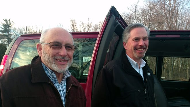 Ed Guley, left, and coordinator Mike Pellicciotti are involved with Holy Family Church's transportation ministry.
