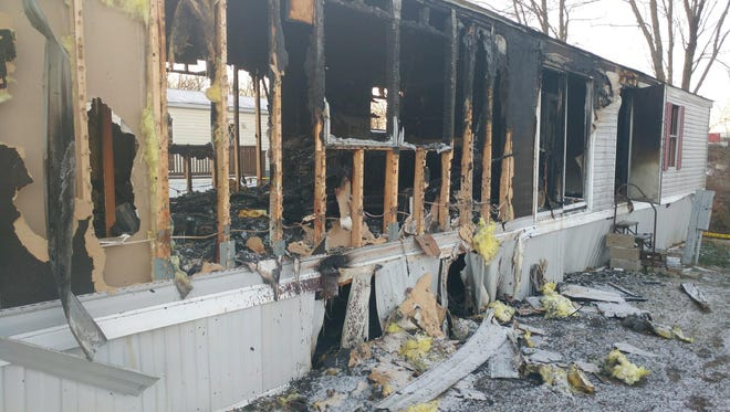 A fire at a mobile home in Salem, Ind. on March 14, 2017. A person was found dead inside the home.