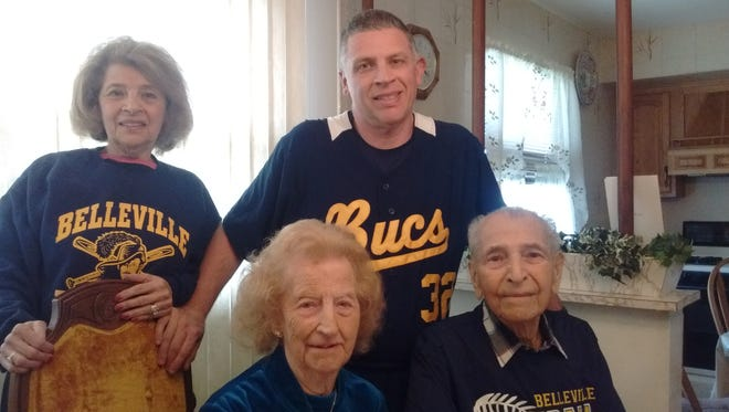 Nick Natalizio (seated, right),  his wife Jennie (seated, left), daughter Ida Sorce (standing, left) and Joe Sorce, Nick's grandson and Belleville High's baseball coach.