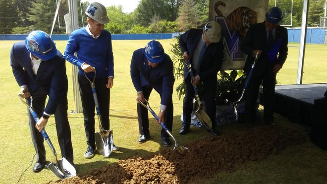 Memphis football coach Mike Norvell, Board of Trustees Vice Chairman Brad Martin, university president Dr. M. David Rudd, Board of Trustees Chairman Alan Graf of FedEx and Memphis athletic director Tom Bowen participate in the groundbreaking ceremony for the football program's new indoor practice facility on April 27, 2017.