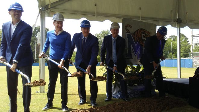 Memphis football coach Mike Norvell, former university president Brad Martin, university president David Rudd, FedEx executive Alan Graf and athletic director Tom Bowen participate in the groundbreaking ceremony for Memphis' indoor football practice facility on April 27, 2017.