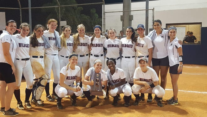 The Estero softball team poses for a photo after winning the program's first district championship in 25 years Thursday. The Wildcats beat Naples, 2-0.