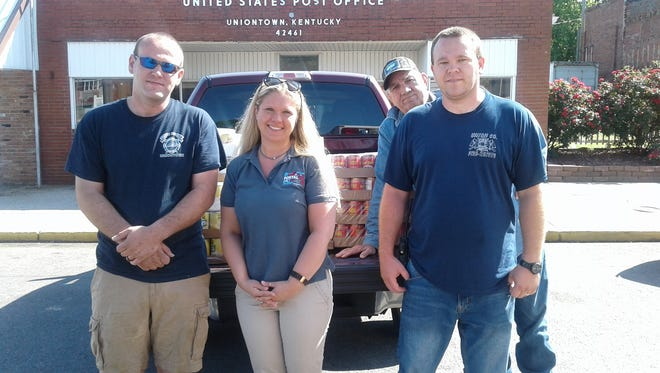 UMWA local 1740 food donation to the US Postal worker's food drive.  Local 1740 donated  $500 worth of canned goods.  Pictured are  OIC Carrie  Griggs,  local 1740 member Terry Russelburg, Uniontown and Union county Volunteer fire Chiefs Josh and Jeremy ??