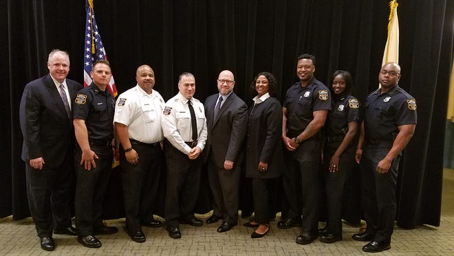 New Jersey Attorney General Christopher S. Porrino, center, gathers with members of the Montclair Police Department who were honored for their work with the community during the attorney general's awards program on May 22 at Rutgers University in Piscataway.