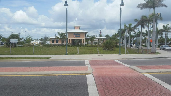 This half-acre lot at 111 S. Ocean Drive, in front of Oculina Bank, could be the location of a 54-space paid parking lot in Fort Pierce.