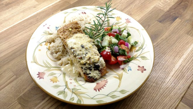This pistachio-encrusted, wild-caught salmon with lemon creme sauce will be served at Sobie's restaurant. Husband and wife Mike and Lydia Sobol are opening the restaurant this fall at 123 E. Wisconsin Ave. in Oconomowoc.