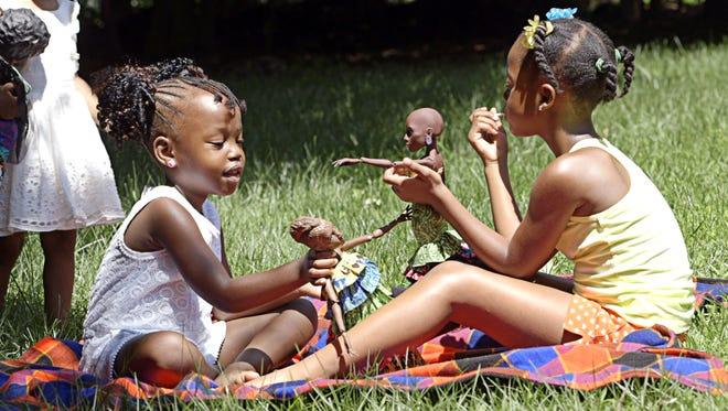 Kimotho's daughter Zara playing with Royelles avatars.