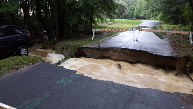 Flooding damaged roads and forced evacuations in Salisbury on Saturday after heavy rains.