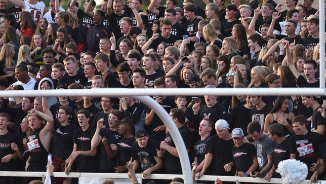 The LaSalle students cheer on their Lancers at the Skyline Chili Crosstown Showdown, Friday, August 25th at LaSalle High School