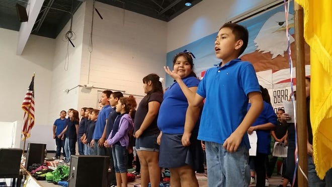 """Mesquite Elementary School students perform songs Thursday, Sept. 7, 2017, during an assembly celebrating the school having earned an """"A"""" in a yearly report card issued by the state."""