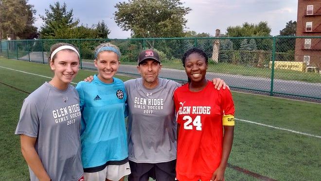 Glen Ridge girls soccer captains: (from left) Liz Hauschild, Victoria Woznick, coach Oscar Viteri and Lindsay Jaiyesimi.