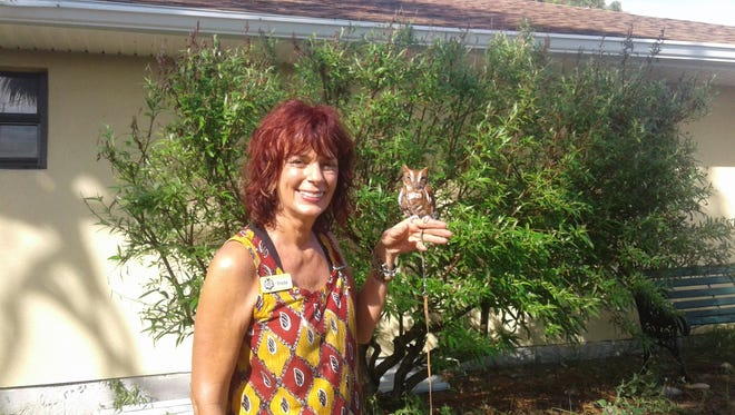 Florida Wildlife Hospital volunteer Freda Toepke shows off her pal Gonzo, an Eastern screech owl and hospital ambassador.