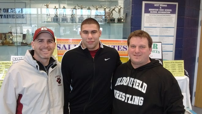 Bloomfield's new head wrestling coach, Ryan Smircich (right), here with Bengals standout wrestler Adam Lutick and assistant coach Jason Galioto after last season's Region 3 championships at West Orange High.